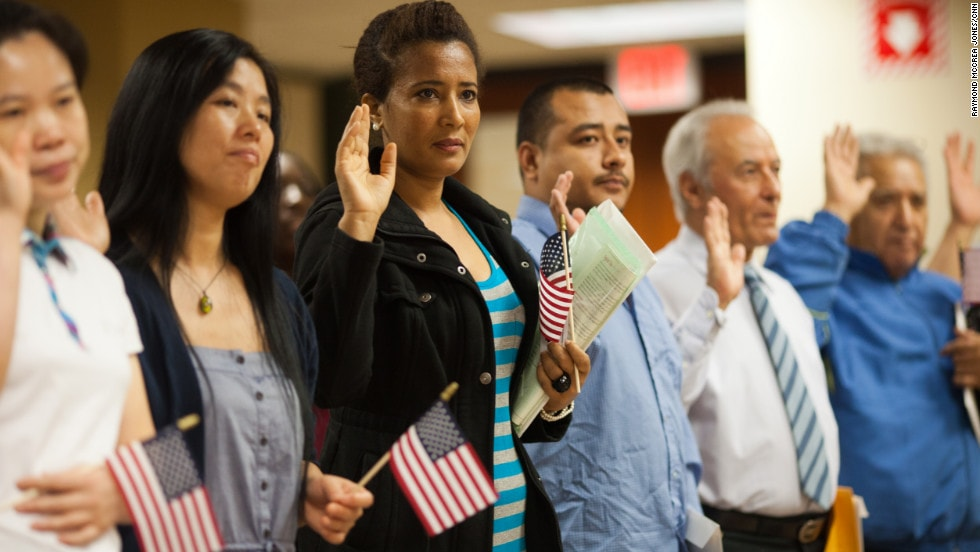 people being sworn in as citizens of the United States